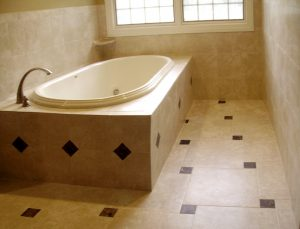 Custom Tiled Bathroom Floor and tub surround